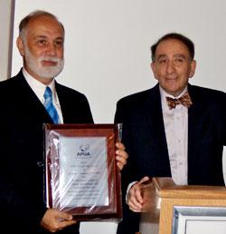 ESCMID president Prof. Giuseppe Cornaglia recied the APUA award 2011 by APUA president Stuart B. Levy